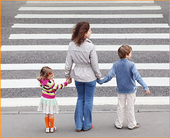 Mom crossing street with kids